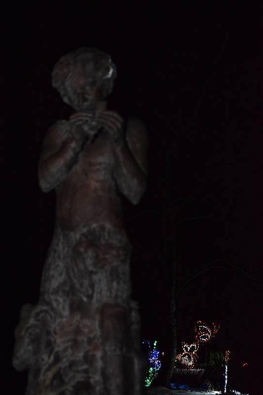 A statue and lights